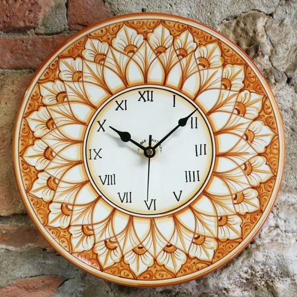 orologio terra di siena da parete in ceramica dipinto a mano in toscana, hand painted rounded clock in ceramic