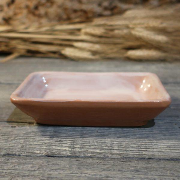 portasapone rustico in ceramica beige e terracotta, soap dish in handcrafted ceramic white on a terracotta background